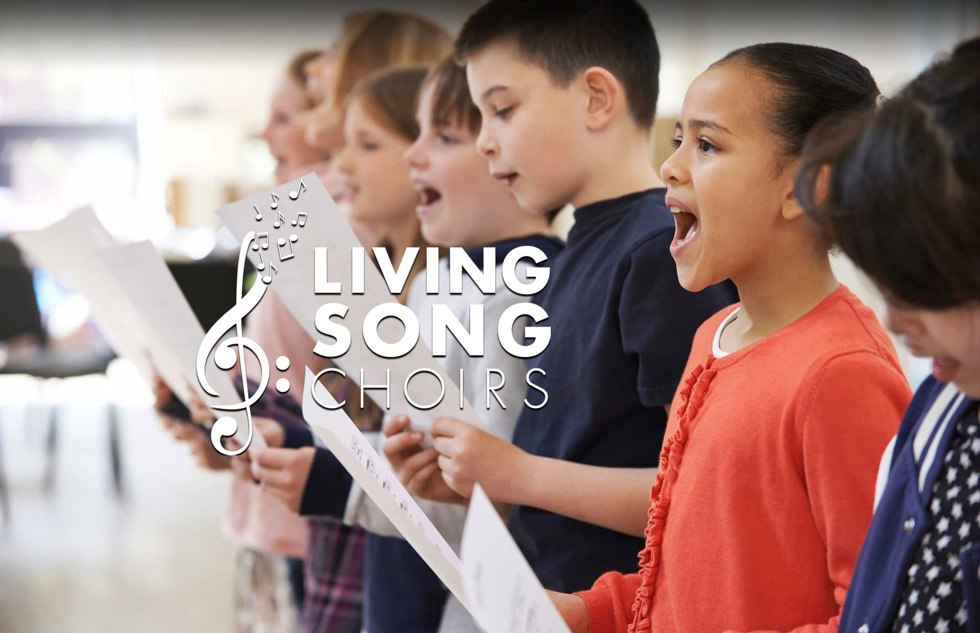 Children singing with Living Song Choirs logo